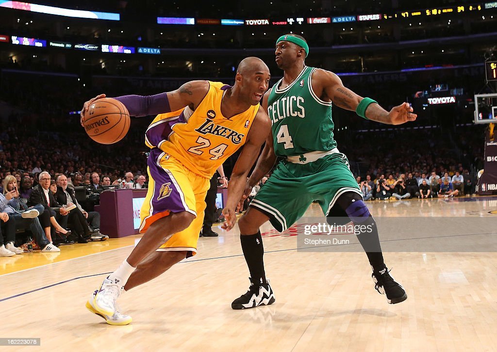 Kobe Bryant #24 of the Los Angeles Lakers drives around Jason Terry #4 of the Boston Celtics at Staples Center on February 20, 2013 in Los Angeles, California.