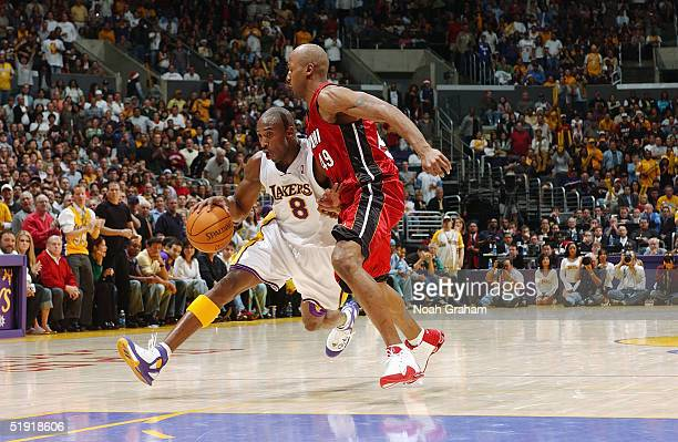 Kobe Bryant of the Los Angeles Lakers drives around Shandon Anderson of the Miami Heat during the game on December 25 2004 at the Staples Center in...