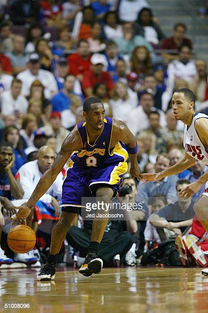Kobe Bryant of the Los Angeles Lakers drives around Tayshaun Prince of the Detroit Pistons in Game four of the 2004 NBA Finals at The Palace of...