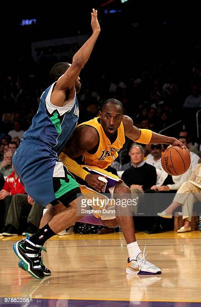 Kobe Bryant of the Los Angeles Lakers drives around Wayne Elllington of the Minnesota Timberwolves on March 19 2010 at Staples Center in Los Angeles...