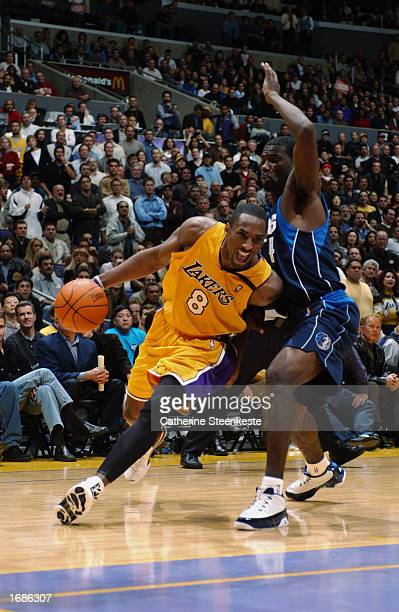 Kobe Bryant of the Los Angeles Lakers drives baseline around Michael Finley of the Dallas Mavericks during the NBA game at Staples Center on December...