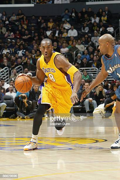 Kobe Bryant of the Los Angeles Lakers drives during a game against the Washington Wizards at Staples Center on December 16 2005 in Los Angeles...