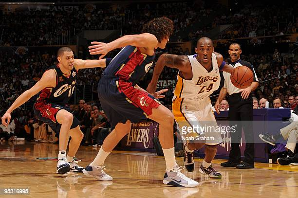 Kobe Bryant of the Los Angeles Lakers drives during a game against the Cleveland Cavaliers at Staples Center on December 25 2009 in Los Angeles...