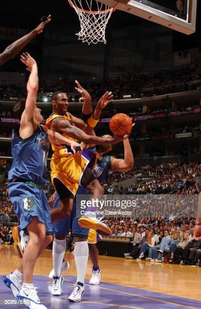 Kobe Bryant of the Los Angeles Lakers drives for a shot attempt against Wally Szczerbiak of the Minnesota Timberwolves in Game three of the Western...