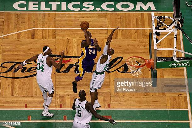 Kobe Bryant of the Los Angeles Lakers drives for a shot attempt against Paul Pierce Kevin Garnett and Ray Allen of the Boston Celltics during Game...