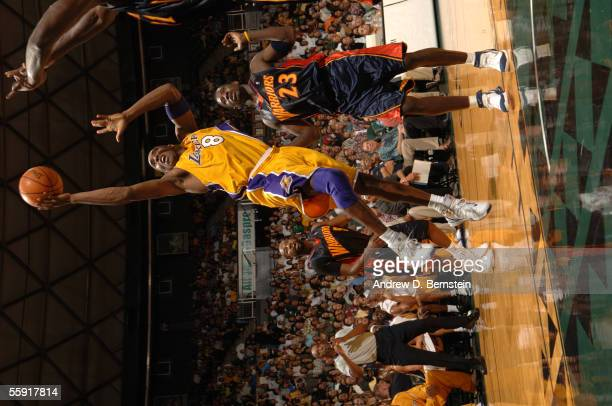 Kobe Bryant of the Los Angeles Lakers drives for a shot attempt against the Golden State Warriors during a preseason game October 11, 2005 at Stan...