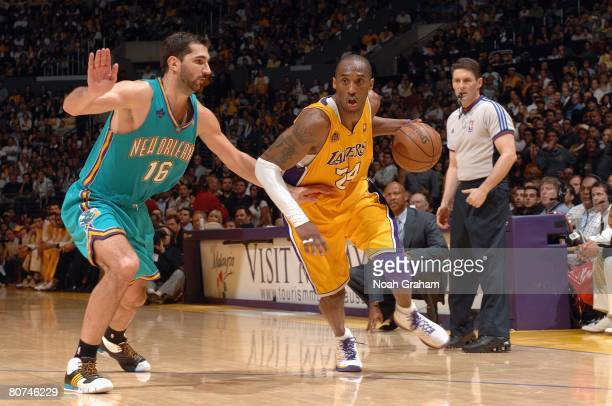 Kobe Bryant of the Los Angeles Lakers drives past Peja Stojakovic of the the New Orleans Hornets during the game at Staples Center on April 11 2008...