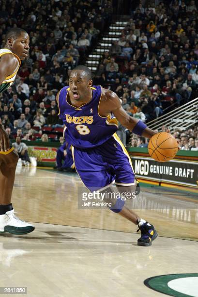 Kobe Bryant of the Los Angeles Lakers drives past Ray Allen of the Seattle SuperSonics January 2 2004 at Key Arena in Seattle Washington NOTE TO USER...