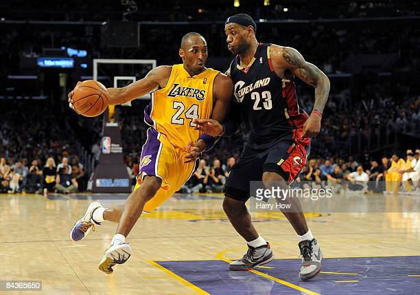 Kobe Bryant of the Los Angeles Lakers drives the ball against LeBron James of the Cleveland Cavaliers during the forth quarter at Staples Center on...