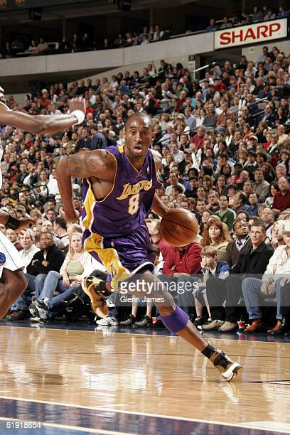 Kobe Bryant of the Los Angeles Lakers drives the ball against the Dallas Mavericks January 5 2005 at the American Airlines Center in Dallas Texas...