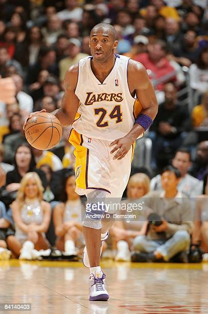 Kobe Bryant of the Los Angeles Lakers drives the ball up court during the game against the Milwaukee Bucks on December 7 2008 at Staples Center in...