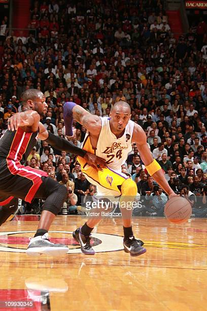 Kobe Bryant of the Los Angeles Lakers drives to the basket against Dwyane Wade of the Miami Heat on March 10 2011 at American Airlines Arena in Miami...