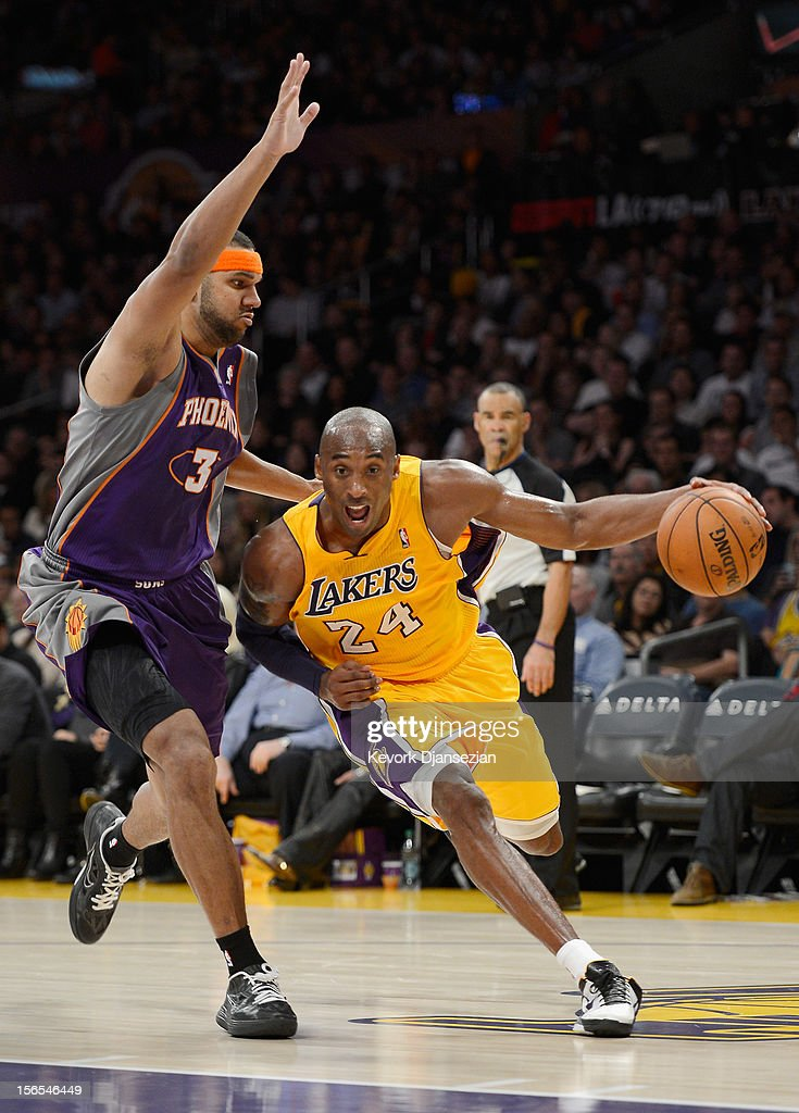 Kobe Bryant #24 of the Los Angeles Lakers drives to the basket against the defense of Jared Dudley #3 of the Phoenix Suns at Staples Center on November 16, 2012 in Los Angeles, California.