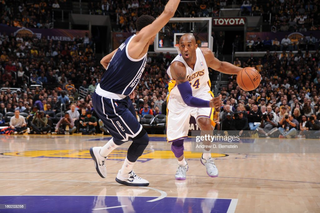 Kobe Bryant #24 of the Los Angeles Lakers drives to the basket against the Oklahoma City Thunder at Staples Center on January 27, 2013 in Los Angeles, California.