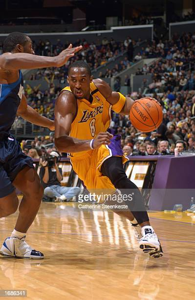 Kobe Bryant of the Los Angeles Lakers drives to the basket against the Dallas Mavericks during the NBA game at Staples Center on December 6, 2002 in...