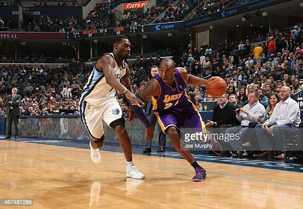 Kobe Bryant of the Los Angeles Lakers drives to the basket against the Memphis Grizzlies on December 17, 2013 at FedExForum in Memphis, Tennessee....