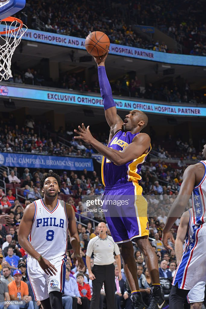 Kobe Bryant #24 of the Los Angeles Lakers drives to the basket against the Philadelphia 76ers at the Wells Fargo Center on December 1, 2015 in Philadelphia, Pennsylvania.