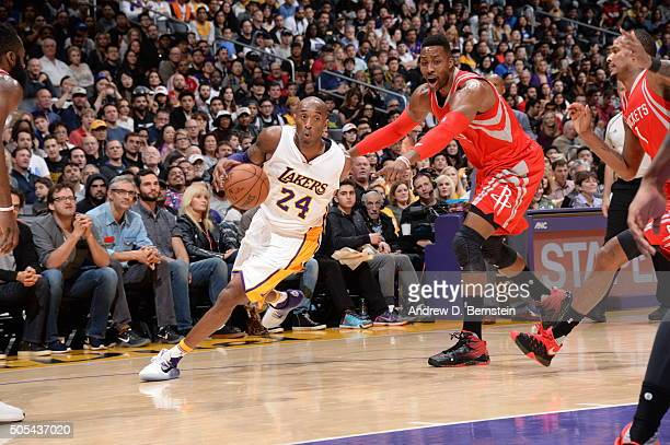 Kobe Bryant of the Los Angeles Lakers drives to the basket against the Houston Rockets on January 17 2016 at STAPLES Center in Los Angeles California...