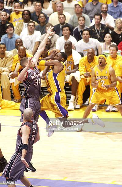 Kobe Bryant of the Los Angeles Lakers drives to the basket against the New Jersey Nets during game one of the 2002 NBA Finals at the Staples Center...