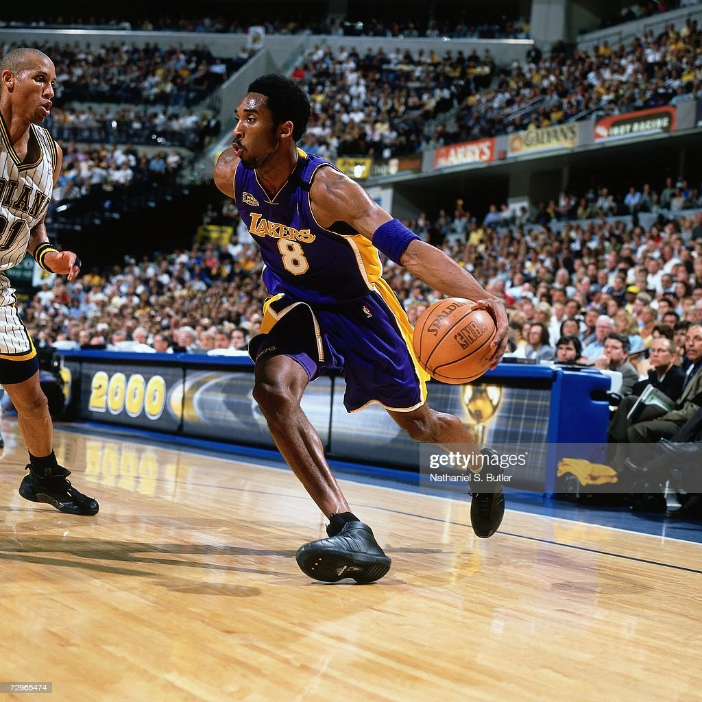 Kobe Bryant Of The Los Angeles Lakers Drives To The Basket