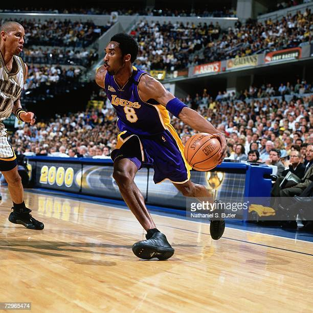 Kobe Bryant of the Los Angeles Lakers drives to the basket against Reggie Miller of the Indiana Pacers during Game Five of the 2000 NBA Finals on...