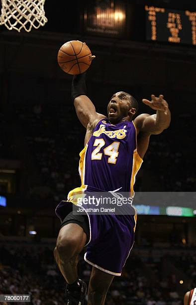 Kobe Bryant of the Los Angeles Lakers drives to the basket against the Milwaukee Bucks on November 21 2007 at the Bradley Center in Milwaukee...