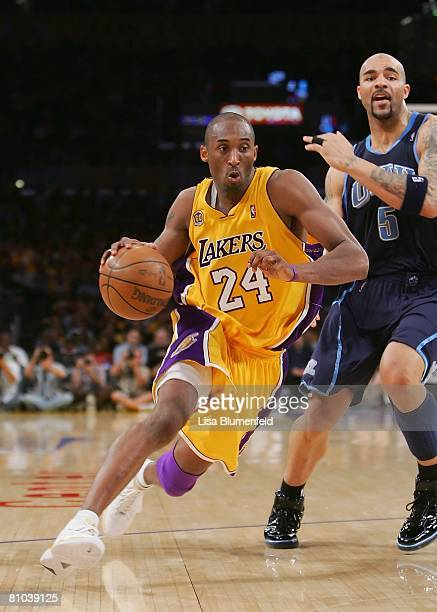 Kobe Bryant of the Los Angeles Lakers drives to the basket against Carlos Boozer of the Utah Jazz in Game Two of the Western Conference Semifinals...