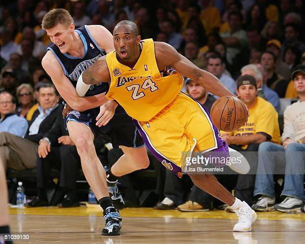 Kobe Bryant of the Los Angeles Lakers drives to the basket against Andrei Kirilenko of the Utah Jazz in Game Two of the Western Conference Semifinals...