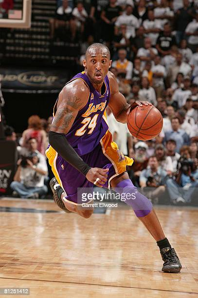 Kobe Bryant of the Los Angeles Lakers drives to the basket against the San Antonio Spurs in Game Four of the Western Conference Finals during the...