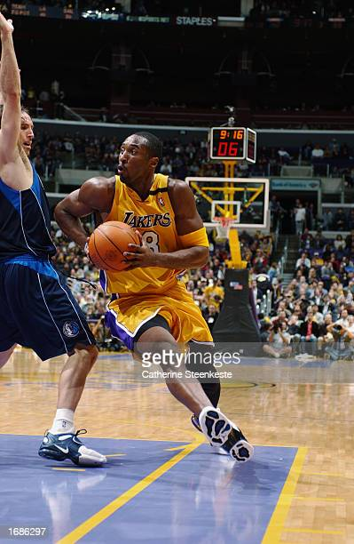 Kobe Bryant of the Los Angeles Lakers drives to the basket around Steve Nash of the Dallas Mavericks during the NBA game at Staples Center on...