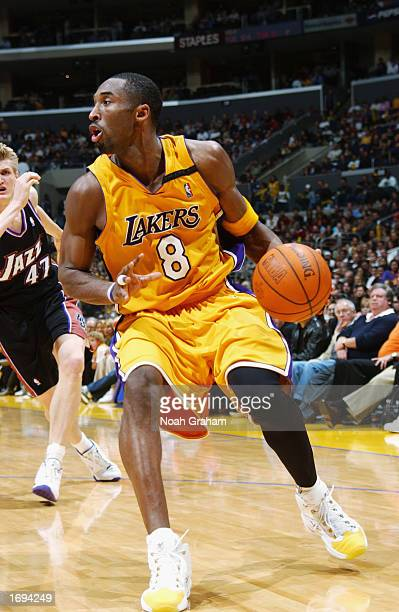 Kobe Bryant of the Los Angeles Lakers drives to the basket during a game against the Utah Jazz at Staples Center on December 8, 2002 in Los Angeles,...