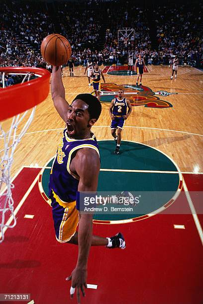 Kobe Bryant of the Los Angeles Lakers drives to the basket for a dunk against the Seattle SuperSonics during the NBA game in 1999 at Key Arena in...
