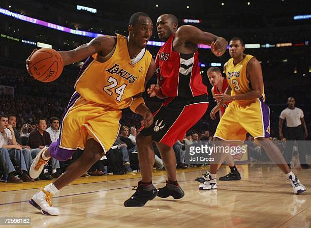 Kobe Bryant of the Los Angeles Lakers drives to the basket past Fred Jones of the Toronto Raptors during the second half of the game on November 17,...
