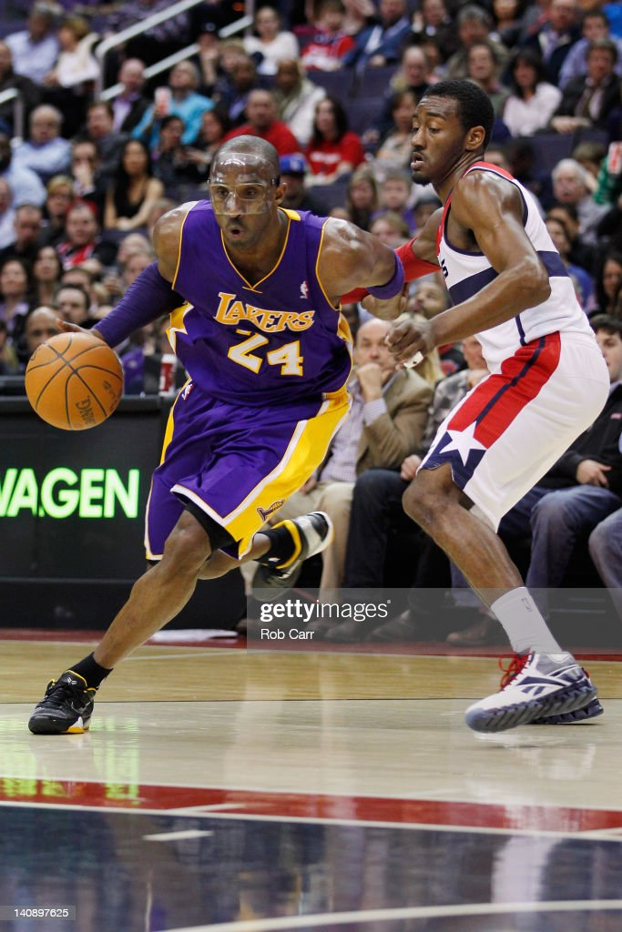 Kobe Bryant #24 of the Los Angeles Lakers drives to the basket while being guarded by John Wall #2 of the Washington Wizards during the first half at the Verizon Center on March 7, 2012 in Washington, DC.