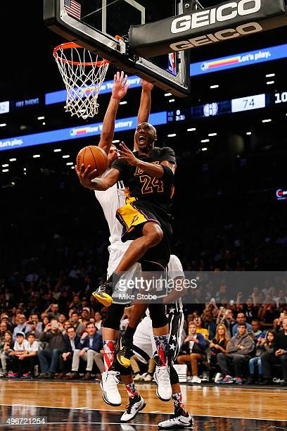 Kobe Bryant of the Los Angeles Lakers drives to the net for a basket against the Brooklyn Nets at the Barclays Center on November 6 2015 in Brooklyn...