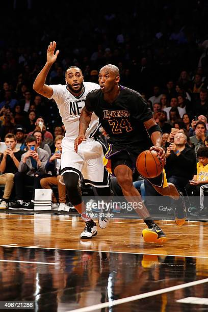 Kobe Bryant of the Los Angeles Lakers drives to the net for a basket against Wayne Ellington of the Brooklyn Nets at the Barclays Center on November...