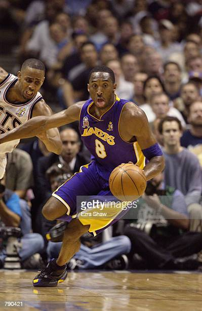 Kobe Bryant of the Los Angeles Lakers drives upcourt in Game four of the 2002 NBA Finals against the New Jersey Nets at Continental Airlines Arena in...
