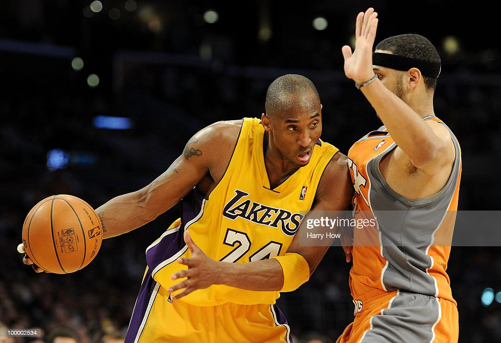 Kobe Bryant #24 of the Los Angeles Lakers drives with the ball against Jared Dudley #3 of the Phoenix Suns in the fourth quarter of Game Two of the Western Conference Finals during the 2010 NBA Playoffs at Staples Center on May 19, 2010 in Los Angeles, California.