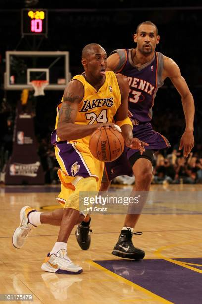 Kobe Bryant of the Los Angeles Lakers drives with the ball in the first quarter of Game Five of the Western Conference Finals against the Phoenix...