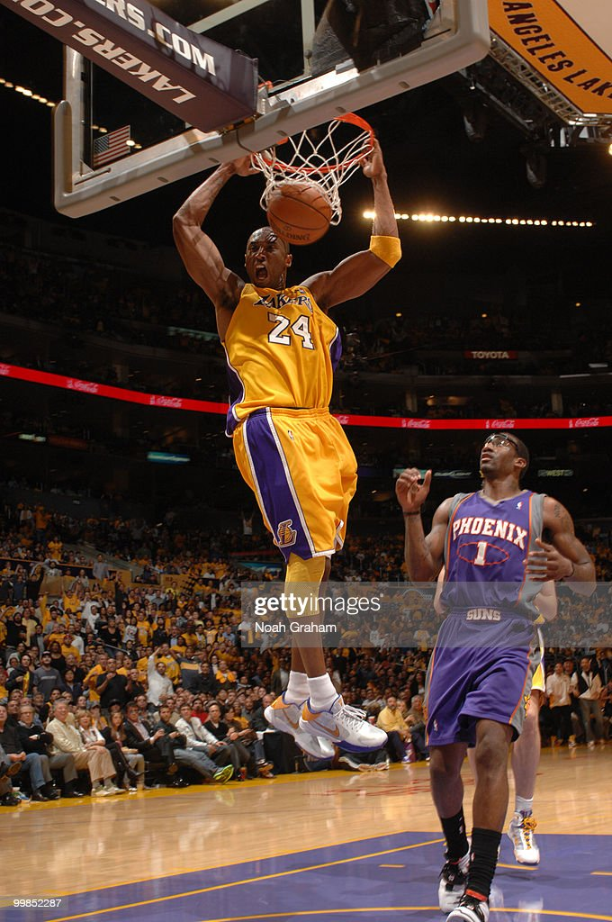 Kobe Bryant #24 of the Los Angeles Lakers dunks against Amar'e Stoudemire #1 of the Phoenix Suns in Game One of the Western Conference Finals during the 2010 NBA Playoffs at Staples Center on May 17, 2010 in Los Angeles, California.