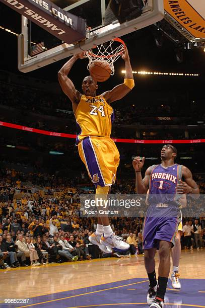 Kobe Bryant of the Los Angeles Lakers dunks against Amar'e Stoudemire of the Phoenix Suns in Game One of the Western Conference Finals during the...