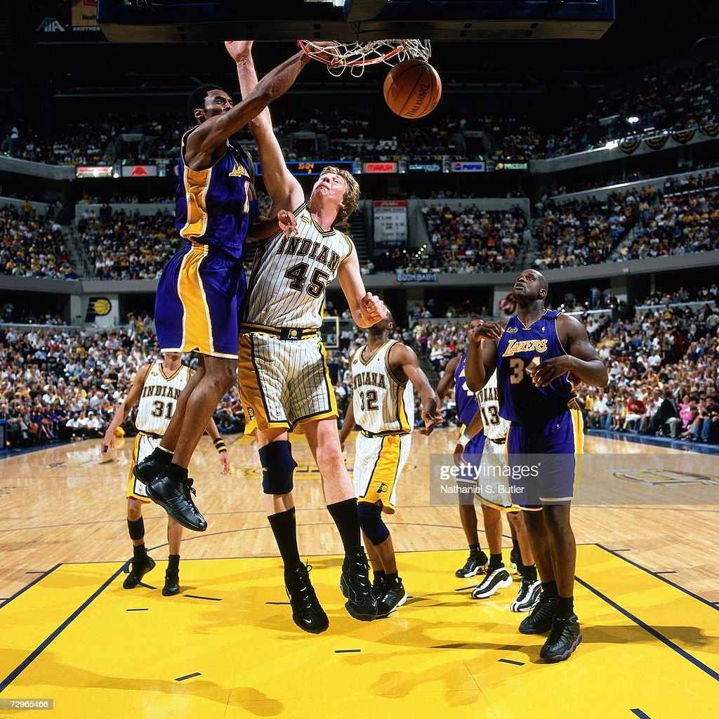 Kobe Bryant Of The Los Angeles Lakers Dunks Against Rick