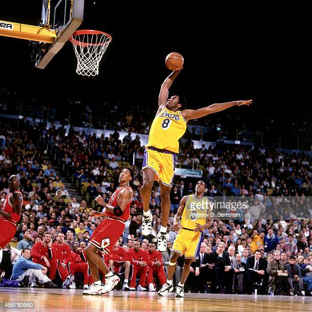 Kobe Bryant of the Los Angeles Lakers dunks against Scottie Pippen of the Chicago Bulls on February 1 1998 at The Forum in Inglewood California NOTE...
