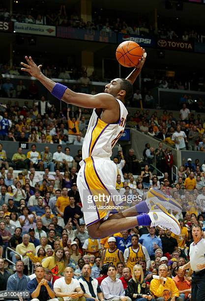 Kobe Bryant of the Los Angeles Lakers dunks against the Detroit Pistons in Game one of the 2004 NBA Finals at Staples Center on June 6 2004 in Los...
