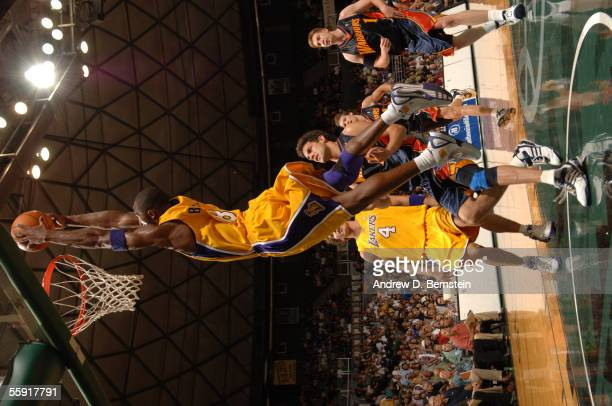 Kobe Bryant of the Los Angeles Lakers dunks against the Golden State Warriors during a preseason game October 11, 2005 at Stan Sheriff Center in...