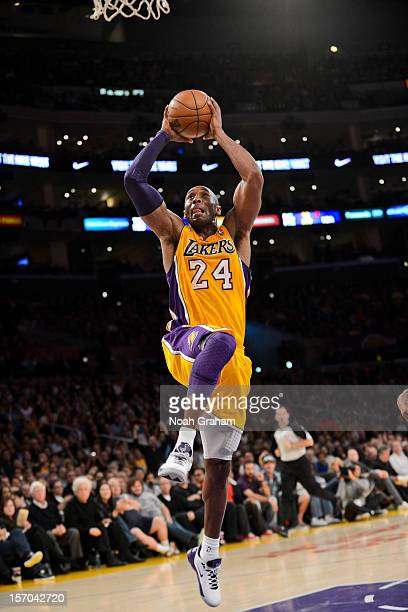 Kobe Bryant of the Los Angeles Lakers dunks against the Indiana Pacers at Staples Center on November 27, 2012 in Los Angeles, California. NOTE TO...