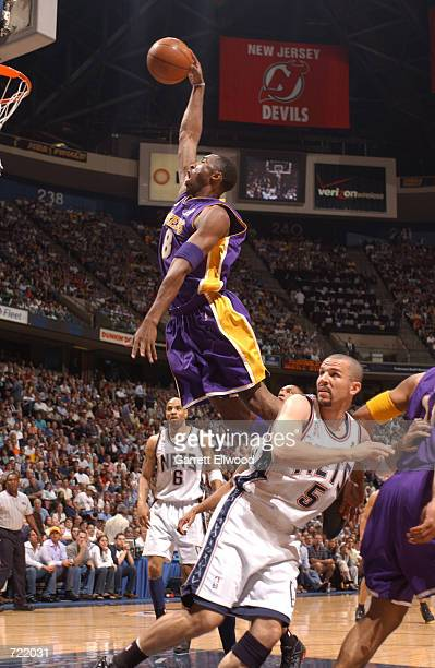 Kobe Bryant of the Los Angeles Lakers dunks against the New Jersey Nets during game four of the 2002 NBA Finals at the Continental Airlines Arena on...