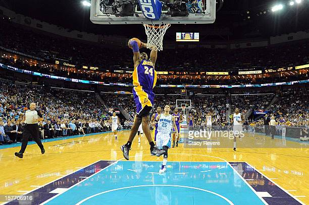 Kobe Bryant of the Los Angeles Lakers dunks against the New Orleans Hornets at New Orleans Arena on December 5, 2012 in New Orleans, Louisiana....