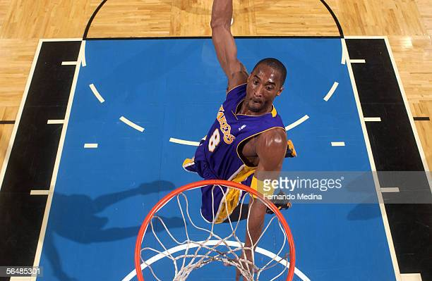Kobe Bryant of the Los Angeles Lakers dunks against the Orlando Magic December 23 2005 at TD Waterhouse Centre in Orlando Florida NOTE TO USER User...