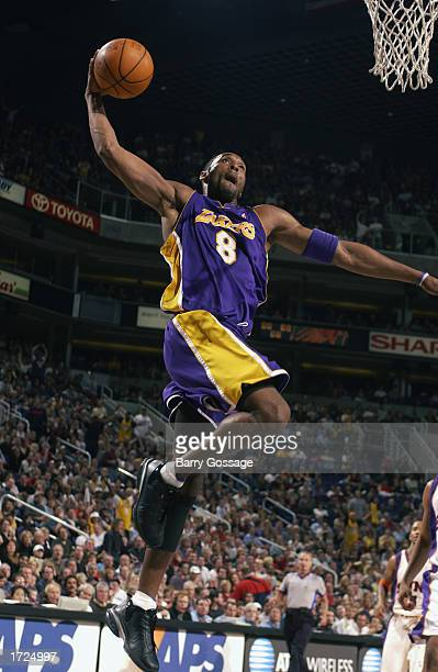 Kobe Bryant of the Los Angeles Lakers dunks against the Phoenix Suns during the game at America West Arena on January 4, 2003 in Phoenix, Arizona....